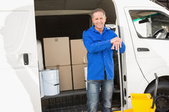 Cleaning agent standing and smiling at camera. In front of his van Royalty Free Stock Photo