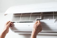 Cleaning air conditioning filter Stock Photography