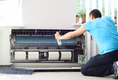 Cleaning the air conditioner royalty free stock photography
