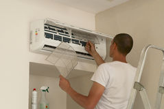 Cleaning the air conditioner Royalty Free Stock Image