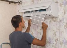 Cleaning the air conditioner Stock Photography