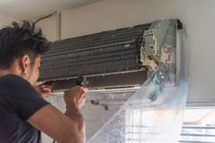 Cleaning air conditioner by water for clean a dust Stock Images