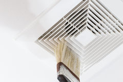 Cleaning air duct with brush. Dust out from Air Duct, Danger and the cause of pneumonia in office man Royalty Free Stock Photography