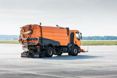 Cleaning the airport apron Stock Image