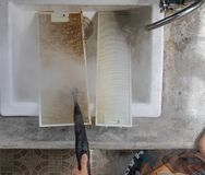 Cleaning aluminum filter for kitchen hood stock images