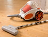 Cleaning of the apartment. Vacuum cleaner on the floor Stock Images