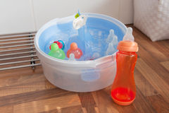 Cleaning the baby bottles Stock Image
