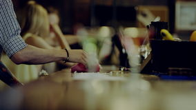 Cleaning a bar counter. Bartender cleaning a bar counter, two martini glasses on foreground stock footage