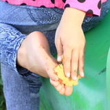 Cleaning bare foot of a little girl Stock Image