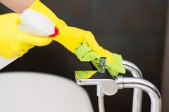 Cleaning bath mixer. Stock Photos