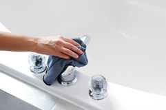 Cleaning bath tub Royalty Free Stock Image