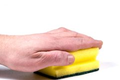 Cleaning the bathroom. Close-up picture of a hand holding a sponge stock photography