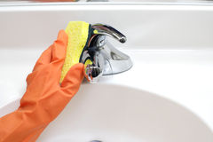 Cleaning Bathroom Sink Royalty Free Stock Photography