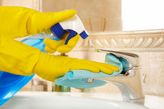 Cleaning the bathroom. Woman in rubber gloves with rag and detergent cleaning the bathroom Royalty Free Stock Image