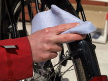 Cleaning a bicycle, closeup royalty free stock image