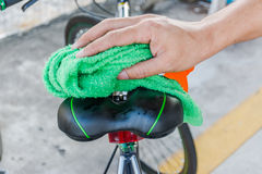 Cleaning body of bicycle Stock Image
