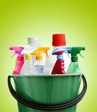 Cleaning bottles. In bucket. Green background Royalty Free Stock Photography
