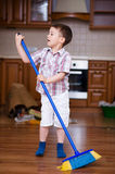 Cleaning. Boy doing housework Royalty Free Stock Photography