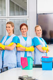 Cleaning brigade working in office. Cleaning brigade working in modern office Stock Image