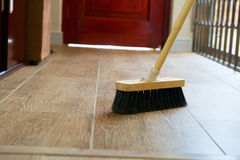 Cleaning broom on wooden floor Royalty Free Stock Photography