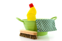 Cleaning with brush and bleach. In green bucket royalty free stock photos