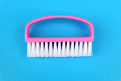 Cleaning brush isolated. On blue background Stock Photos