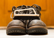 Cleaning brush and leather boots close-up. I Royalty Free Stock Photos