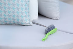 Cleaning brush on outdoor furniture Royalty Free Stock Image