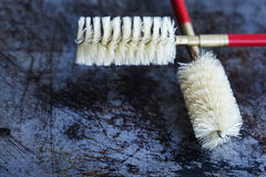 Cleaning brushes on aged shabby scratch textured background. vintage brush with plastic bristle Royalty Free Stock Photography