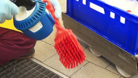 Cleaning of brushes in the food industry stock video