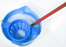 Cleaning bucket. Blue bucket with water,soap and red mop Royalty Free Stock Image