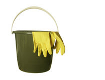 Cleaning bucket with rubber gloves. Cleaning bucket with yellow gloves isolated over white background Stock Photo