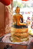 Cleaning buddha festival at songkarn festival Thailand. The ceremony pour buddha statue water in Lampang Thailand Royalty Free Stock Photo