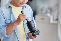 Cleaning camera Royalty Free Stock Photos