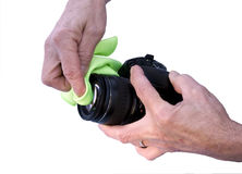 Cleaning camera lens Royalty Free Stock Photo