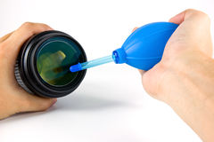 Cleaning camera lens Royalty Free Stock Images