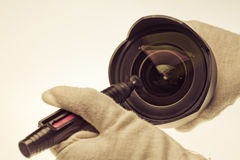 Cleaning Camera Lens Stock Image