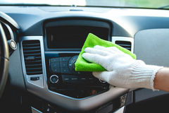 Cleaning the car dashboard Royalty Free Stock Photography