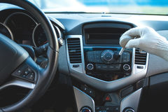 Cleaning the car dashboard Stock Photography