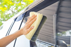 Cleaning car glass with a fabric Stock Photo