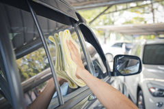 Cleaning car glass with a fabric Royalty Free Stock Photos