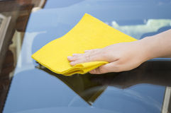 Cleaning car glass. Man cleaning car glass front Stock Images