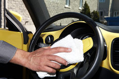 Cleaning the car. Hand with microfiber cloth Royalty Free Stock Photo