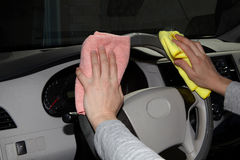 Cleaning the car. Hand with microfiber cloth Stock Images