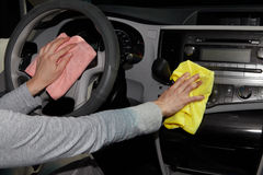 Cleaning the car. Hand with microfiber cloth Royalty Free Stock Image