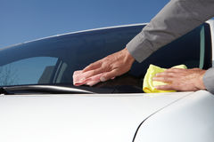 Cleaning the car. Hand with microfiber cloth Stock Photo