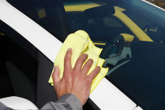 Cleaning the car. Hand with microfiber cloth Royalty Free Stock Images