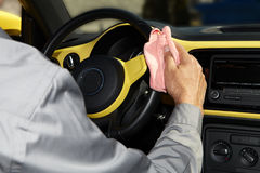 Cleaning the car. Hand with microfiber cloth Stock Photography