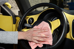 Cleaning the car. Hand with microfiber cloth Stock Image