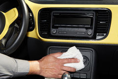 Cleaning the car. Hand with microfiber cloth Royalty Free Stock Photography
